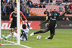 May 13, 2017 - Washington, District Of Columbia, USA - D.C. United defender Kofi Opare (6) clears a ball after D.C. United goalkeeper Bill Hamid (28) made a save. (Credit Image: © Alex Edelman via ZUMA Wire)