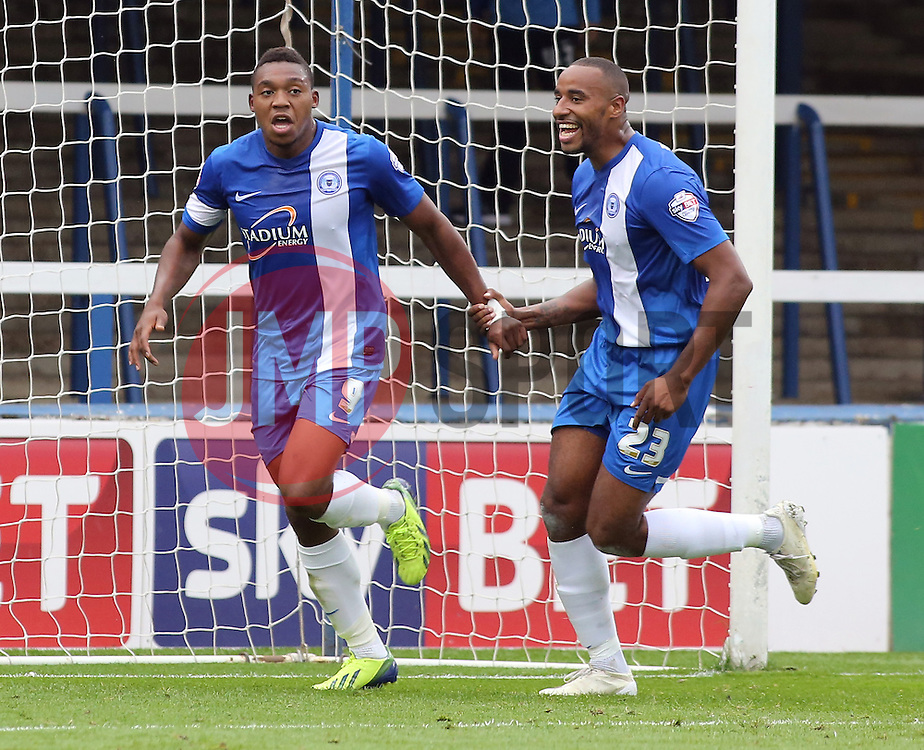Peterborough United's Britt Assombalonga celebrates scoring with Peterborough United's Tyrone Barnett - Photo mandatory by-line: Joe Dent/JMP - Tel: Mobile: 07966 386802 21/09/2013 - SPORT - FOOTBALL - London Road Stadium - Peterborough - Peterborough United V MK Dons - Sky Bet League 1