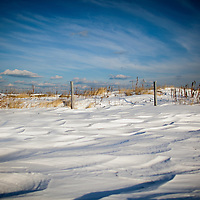 Snow covered dunes at Sandy Hook Gateway National Recreation area in Middletown NJ.  The snow almost sand like in pattern is the results of a recent storm that dumped 14 inches on the area.