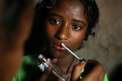 Tsegaya Mekonen, 13, gets ready to meet her groom Talema Meseret, 23, on their wedding day in Yeganda Village, Amhara Region, Ethiopia on May 20, 2007. The practice of early marriage remains widespread in Ethiopia, especially in the northern Amhara and Tigray regions, where parents consent to their daughters' consummated marriages when they are still as young as 10 or 12. In Amhara, 50 percent of girls are married by the age of 15, despite the enactment in 2000 of the revised Family Law, which sets the legal age for marriage at 18.