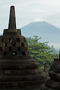 Stupa with volcano Merbabu capped in clouds in the background, Borobudur, Kedu Valley, South Central Java, Java, Indonesia, Southeast Asia