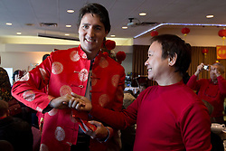 Liberal leader Justin Trudeau, left, is greeted while handing out lucky red envelopes to celebrate the Lunar New Year during a meet and greet with the Chinese Freemasons at the Pink Pearl Chinese Restaurant in Vancouver, B.C., on Friday January 31, 2014. THE CANADIAN PRESS/Darryl Dyck /ABACAPRESS.COM  | 521043_072 VANCOUVER Canada