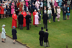 Queen Elizabeth II greets guests during a Royal Garden Party at Buckingham Palace in London.
