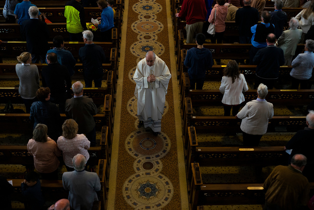 Fr. Dermod McCarthy greets people attending Sunday mass at St. Mary's Pro-Cathedral in Dublin City centre, on May 13, 2018.