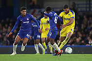 AFC Wimbledon striker Jake Jervis (10) getting fouled by Tariq Lamptey of Chelsea (61) during the EFL Trophy match between U21 Chelsea and AFC Wimbledon at Stamford Bridge, London, England on 4 December 2018.