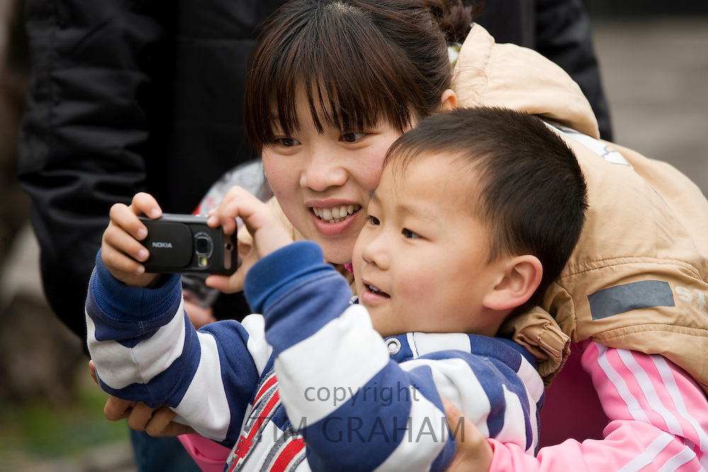 Mother and son at Summer Palace, Beijing. China has a one child family planning policy to reduce population.