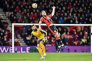 AFC Bournemouth Midfielder, Dan Gosling (4) beats Arsenal Forward, Olivier Giroud (12) to the ball in the air during the Premier League match between Bournemouth and Arsenal at the Vitality Stadium, Bournemouth, England on 3 January 2017. Photo by Adam Rivers.
