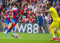 Football - 2021/2022  Premier League - Crystal Palace vs Brentford - Selhurst Park  - Saturday 21st August 2021.<br /> <br /> Wilfried Zaha (Crystal Palace) attacks the Brentford defence at Selhurst Park.<br /> <br /> COLORSPORT/DANIEL BEARHAM