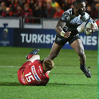 Rugby Union - 2017 / 2018 European Rugby Champions Cup: Scarlets vs. RC Toulonnaise<br /> <br /> Semi Radradra, of Toulon tackled by Rhys Patchell of Llanelli Scarlets , at Parc y Scarlets, Llanelli.<br /> <br /> COLORSPORT/WINSTON BYNORTH