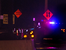 October 7, 2016 - Florida, U.S. - Palm Beach police man a roadblock at the east end of the Flagler Memorial Bridge before dawn  Friday, October 7, 2016 after the passing of Hurricane Matthew.  Police were not allowing anyone onto the island except residents and business owners. (Credit Image: © Lannis Waters/The Palm Beach Post via ZUMA Wire)
