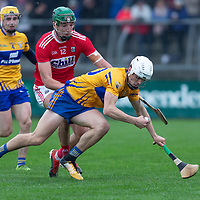 Clare's Aidan McCarthy falls under pressure from Cork's Aidan Walsh