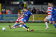 AFC Wimbledon midfielder Callum Reilly (33) scoring goal to make it 2-1 during the EFL Sky Bet League 1 match between AFC Wimbledon and Doncaster Rovers at the Cherry Red Records Stadium, Kingston, England on 14 December 2019.