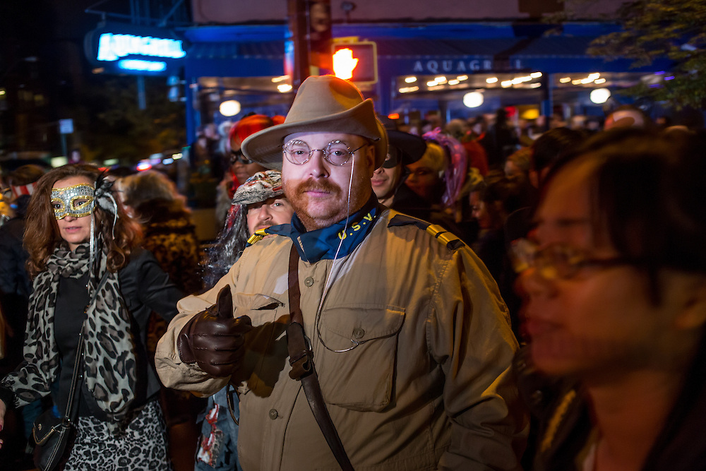 New York, NY - 31 October 2015. A man in a Rough Rider costume, and made up to look like Theodore Roosevelt, gives a thumbs-up sign in the annual Greenwich Village Halloween Parade.