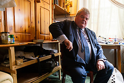 Thomas Mathew, 73, in his Earls Court bedsit, London, where he has been campaigning to reopen investigations to his brother Theobald's death in France in 1983. He believes that if he can prove his brother's body was never buried then he will be able to pursue the French authorities in what he believes is a cover-up.. London, September 14 2018.