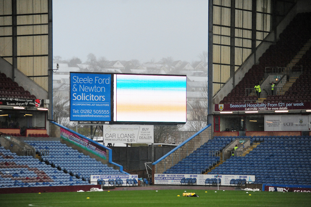 A general view of Turf Moor home of Burnley Football Club, with snow on the roof tops of houses behind the stadium<br /> <br /> Photographer Chris Vaughan/CameraSport<br /> <br /> Football - Barclays Premiership - Burnley v Crystal Palace - Saturday 17th January 2015 - Turf Moor - Burnley<br /> <br /> © CameraSport - 43 Linden Ave. Countesthorpe. Leicester. England. LE8 5PG - Tel: +44 (0) 116 277 4147 - admin@camerasport.com - www.camerasport.com