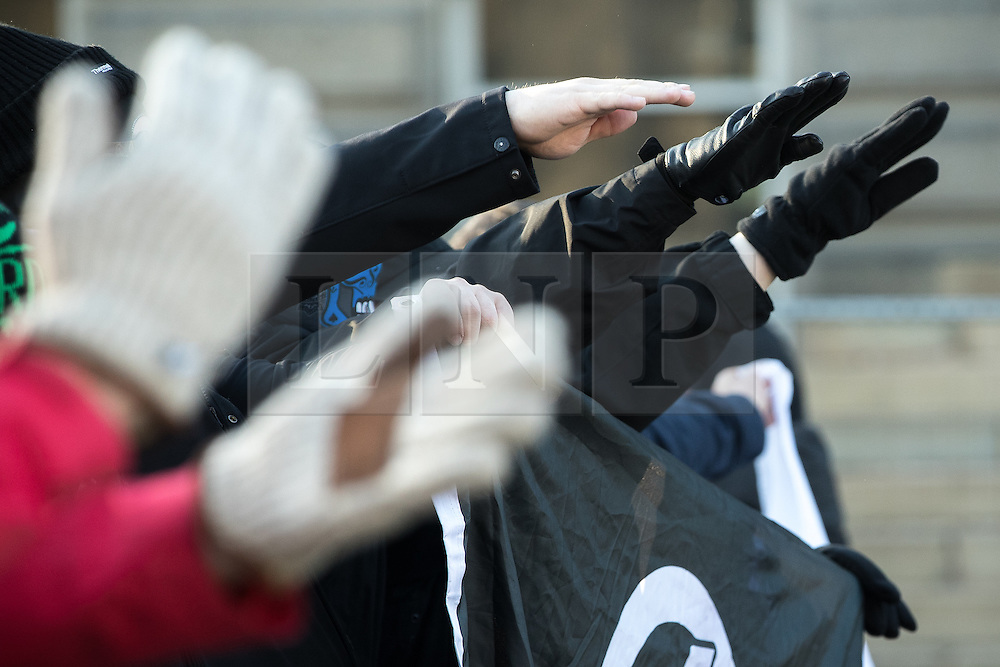 "© Licensed to London News Pictures . 26/11/2016 . Bolton , UK . Those opposed to mosques , pictured giving Nazi salutes at the demonstration . Approximately 100 people attend a demonstration against the construction of mosques in Bolton , under the banner "" No More Mosques "" , organised by a coalition of far-right organisations and approximately 150 anti fascists opposing the demonstration , in Victoria Square in Bolton Town Centre . Photo credit : Joel Goodman/LNP"