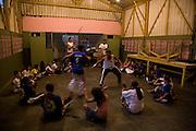 Capoeira practice in vila dos pescadores favela, Cubatão