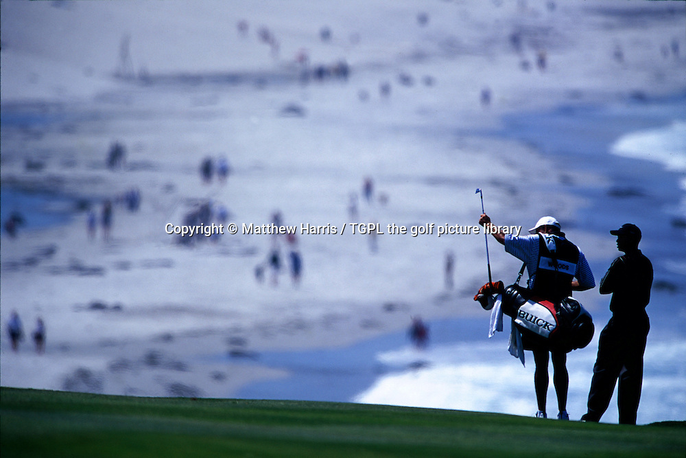Tiger WOODS (USA) waits with his caddie steve Williams (NZ) on the 9th fairway after playing his 2nd shot to the green during fourth round US Open Championship 2000, Pebble Beach Golf Links,Pebble Beach,California,USA.
