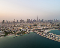 Panoramic aerial view of the skyscrapers in the mist in Dubai, U.A.E.