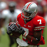 MORNING JOURNAL/DAVID RICHARD.Ted Ginn Jr. of Ohio State pulls in a 58-yard touchdown pass from Troy Smith yesterday in the first quarter.