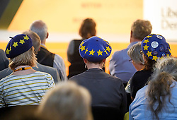 © Licensed to London News Pictures. 18/09/2018. Brighton, UK.  Delegates wearing EU flag themed hats attend the final day of the Liberal Democrat Autumn Conference in Brighton, East Sussex on September 18, 2018. This years event has been mainly focused around Brexit, the UK's departure from the EU. Photo credit: Ben Cawthra/LNP