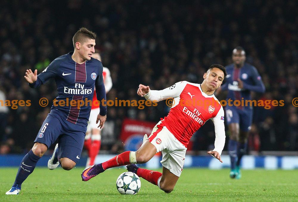 Marco Verratti of Paris Saint-Germain  (left) fouls Alexis Sanchez of Arsenal during the UEFA Champions League match between Arsenal and Paris Saint-Germain at the Emirates Stadium in London. November 23, 2016.<br /> Arron Gent / Telephoto Images<br /> +44 7967 642437