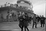 The Beatles arrive in Ireland to play their only gig in the country in the Adelphi Cinema on 7 November 1963.  George Harrison waylaid by an enthusiastic Dubliner who climbed the railings at Dublin Airport..07.11.1963