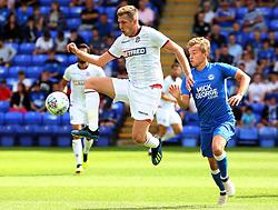 Josh Vela of Bolton Wanderers controls the ball away from Louis Reed of Peterborough United - Mandatory by-line: Joe Dent/JMP - 28/07/2018 - FOOTBALL - ABAX Stadium - Peterborough, England - Peterborough United v Bolton Wanderers - Pre-season friendly