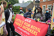 Royal Parks workers outsourced via French multinational VINCI Facilities hold a strike meeting during a picket outside the Old Police House in Hyde Park as part of joint strike action by the United Voices of the World UVW and Public and Commercial Services PCS trade unions on 30th July 2021 in London, United Kingdom. The joint strike, with members dual carding over pay, conditions and the sacking of a member of staff, is believed to be the first between a TUC and a non-TUC trade union and follows the launch of a legal challenge by the Royal Parks workers against indirect racial discrimination by the Royal Parks.