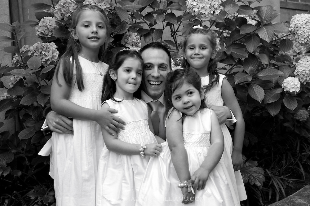The groom poses with flower girls at Berkeley City Club.