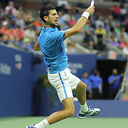 2016 U.S. Open - Day 14  Novak Djokovic of Serbia in action against Stan Wawrinka of Switzerland in the Men's Singles Final on Arthur Ashe Stadium on day fourteen of the 2016 US Open Tennis Tournament at the USTA Billie Jean King National Tennis Center on September 11, 2016 in Flushing, Queens, New York City.  (Photo by Tim Clayton/Corbis via Getty Images)