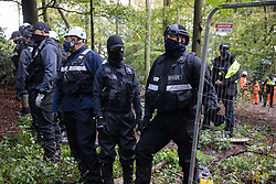 Aylesbury Vale, UK. 1st October, 2020. National Eviction Team bailiffs working on behalf of HS2 Ltd, facilitated by Thames Valley Police, form a line during evictions of anti-HS2 activists from a wildlife protection camp in the ancient woodland which inspired Roald Dahl's Fantastic Mr Fox at Jones' Hill Wood. Around 40 environmental activists and local residents, some of whom living in makeshift tree houses 60 feet above the ground, were present during the evictions at Jones' Hill Wood which had served as one of several protest camps set up along the route of the £106bn HS2 high-speed rail link in order to resist the controversial infrastructure project.