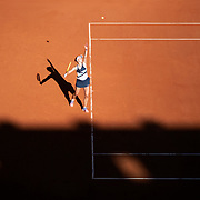 PARIS, FRANCE June 10. Barbora Krejcikova of the Czech Republic serving against Maria Sakkari of Greece as the early evening shadows creep across Court Philippe-Chatrier during the semi finals of the Women's singles competition at the 2021 French Open Tennis Tournament at Roland Garros on June 10th 2021 in Paris, France. (Photo by Tim Clayton/Corbis via Getty Images)