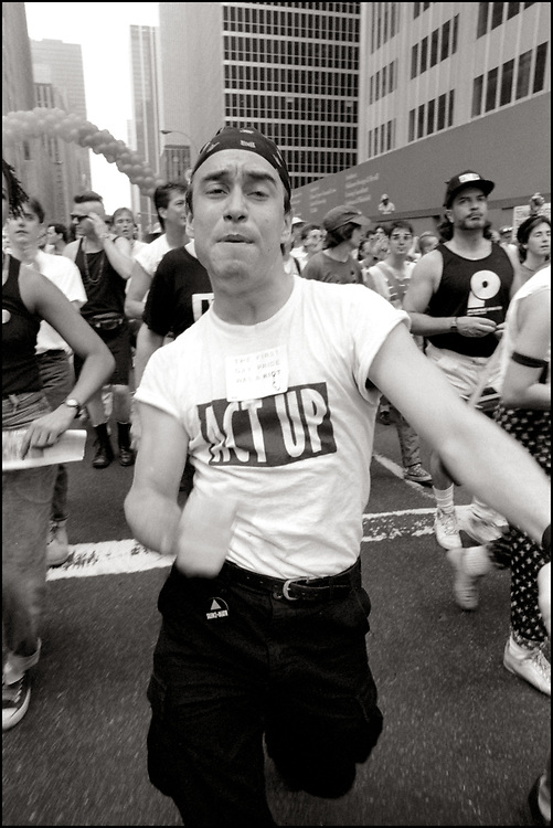 """Tony Mallairis of ACT UP NY, on June 24, 1989, the 20th anniversary of the Stonewall riots, participating in a renegade march up 6th avenue to Central Park. Themed, """"In The Tradition"""", this march followed the same route as the original march 20 years ago and was designed as a rebuke to the corporatization of the gay pride parade."""