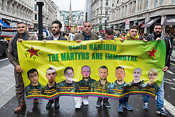 London, UK. 13 October, 2019. Kurdish supporters of the YPG march in protest against Turkey's invasion of Kurdish-held territory in north-eastern Syria. According to the UN, 13,000 people have left their homes since the launch earlier this week of the assault by Turkey and Syrian rebel fighters. At least 38 civilians and more than 80 Kurdish fighters are reported to have been killed killed.