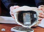 Moscow, Russia, 29/01/2006..Image from Russian television documentary expanding on allegations by the Russian Federal Security Service of spying by British embassy diplomats in Moscow. The image shows a Russian intelligence officer demonstrating a rock containing electronic equipment allegedly used by British spies for communicating with Russian agents working for the British intelligence services.