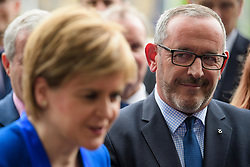 © Licensed to London News Pictures. 12/06/2017. London, UK. STEWART HOSIE MP (right) watches as SNP leader NICOLA STURGEON holds a photocall and press conference outside parliament with her newly elected MPs. Over the weekend British prime minister Theresa May formed a new cabinet and continues discussions with the DUP in an attempt to form a new government. Photo credit: Ben Cawthra/LNP