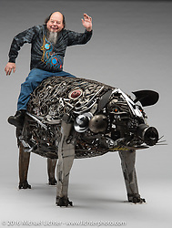 """""""Chris P. Bacon"""", a metal art pig sculpture built by Ron Finch of Finch's Custom Cycles in Pontiac, MI. Photographed by Michael Lichter during the Easyriders Bike Show in Columbus, OH on February 21, 2016. ©2016 Michael Lichter."""