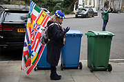 Anti Brexit protesterwith flag of European nations standing by some bins in Westminster outside Europe House, the European Parliament Liason office in the UK on 8th January 2020 in London, England, United Kingdom. With a majority Conservative government in power and Brexit day at the end of January looming, the role of these protesters is now to demonstrate in the hope of the softest Brexit deal possible.