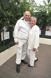 VINCE CABLE MP and his wife RACHEL at the RHS Chelsea Flower Show 2009 held inthe gardens of the Royal Hospital Chelsea on 18th May 2009.
