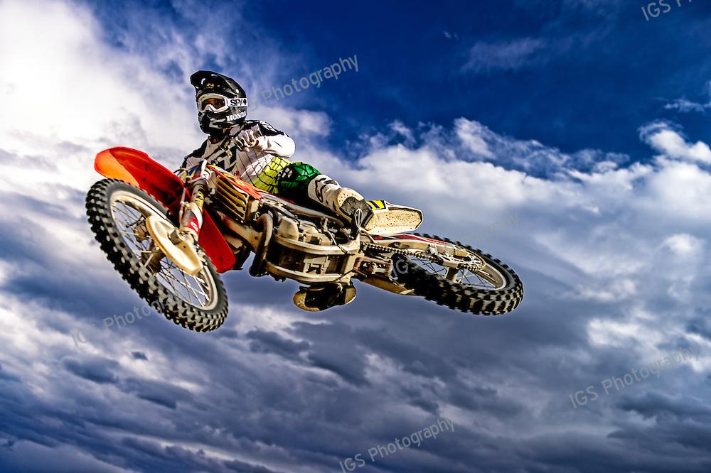 Motorcross rider performing Freestyle jump