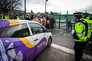 The NACCS (Nationwide Accommodation Services Ltd) management team arrive back at Napier Barracks to a peaceful protest by asylum seekers who are currently being held there in awful conditions on the 12th of January 2021 in Folestone Kent. Over 400 asylum seekers are being kept at Napier Barracks in unsuitable, cold accommodation that is managed by NACCS a property management company used by the UK Boarder Agency. Asylum seekers are experiencing mental health issues as well as being vulnerable to health conditions including COVID-19.  (photo by Andy Aitchison)