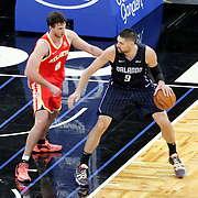 ORLANDO, FL - MARCH 03: Danilo Gallinari #8 of the Atlanta Hawks defends against Nikola Vucevic #9 of the Orlando Magic during the second half at Amway Center on March 3, 2021 in Orlando, Florida. NOTE TO USER: User expressly acknowledges and agrees that, by downloading and or using this photograph, User is consenting to the terms and conditions of the Getty Images License Agreement. (Photo by Alex Menendez/Getty Images)*** Local Caption *** Danilo Gallinari; Nikola Vucevic