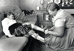 Disabled girl with her mother, UK 1990