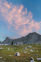 Alpenglow and moon over Pronghorn and Dragon Head Peaks. Bridger Wilderness. Wind River Range, Wyoming