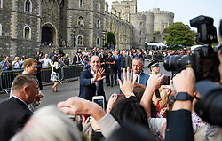 © Licensed to London News Pictures. 18/05/2018. London, UK. PRINCE HARRY and PRINCE WILLIAM on a walkabout outside Windsor Castle on the eve of the wedding of Prince Harry to Meghan Markle.. Prince Harry and Meghan Markle are to be married tomorrow (Saturday) at St George's Chapel in Windsor. Photo credit: Ben Cawthra/LNP