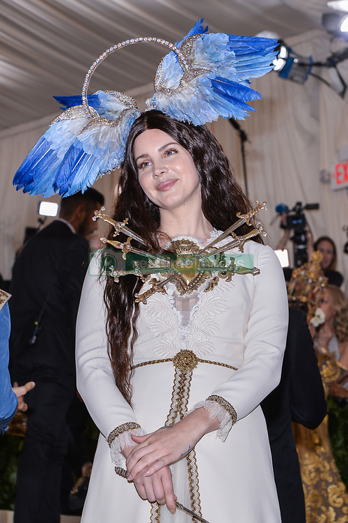 Lana del Rey walking the red carpet at The Metropolitan Museum of Art Costume Institute Benefit celebrating the opening of Heavenly Bodies : Fashion and the Catholic Imagination held at The Metropolitan Museum of Art  in New York, NY, on May 7, 2018. (Photo by Anthony Behar/Sipa USA)