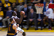 Golden State Warriors forward Draymond Green (23) takes the ball to the basket against Cleveland Cavaliers forward Kevin Love (0) during Game 1 of the NBA Finals at Oracle Arena in Oakland, Calif., on June 1, 2017. (Stan Olszewski/Special to S.F. Examiner)