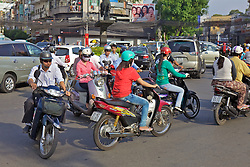 Scooters Making Wy Through Traffic