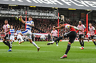 Brentford Defender Yoann Barbet (29) takes a shot on goal during the EFL Sky Bet Championship match between Brentford and Queens Park Rangers at Griffin Park, London, England on 2 March 2019.